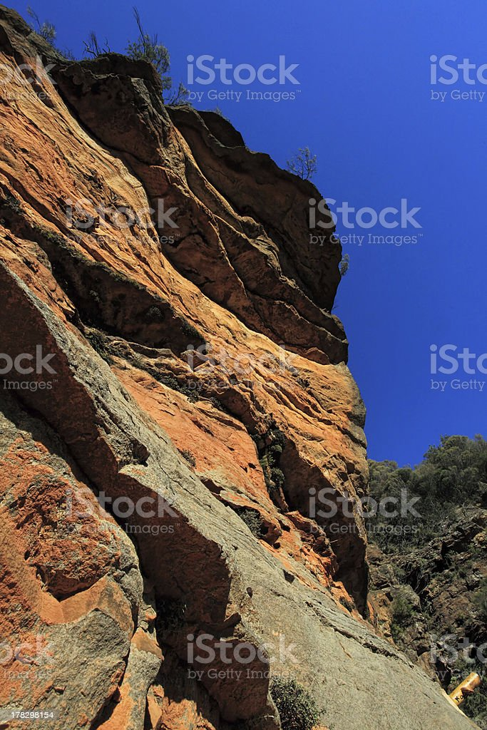 Awe inspiring red cliffs along the National Pass - Australia stock photo