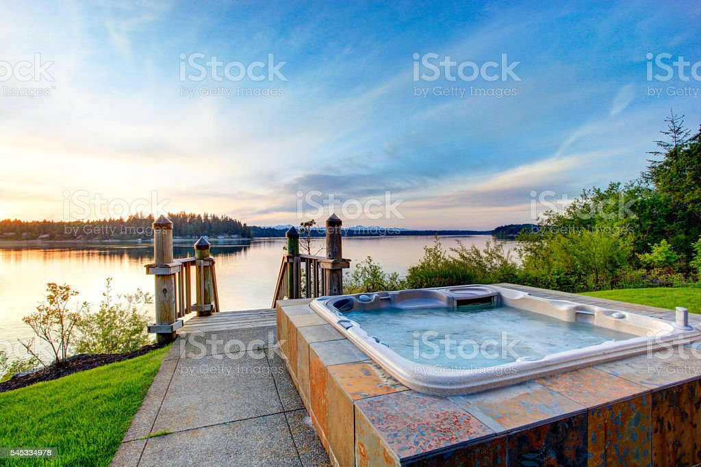 Awesome water view with hot tub at dusk stock photo