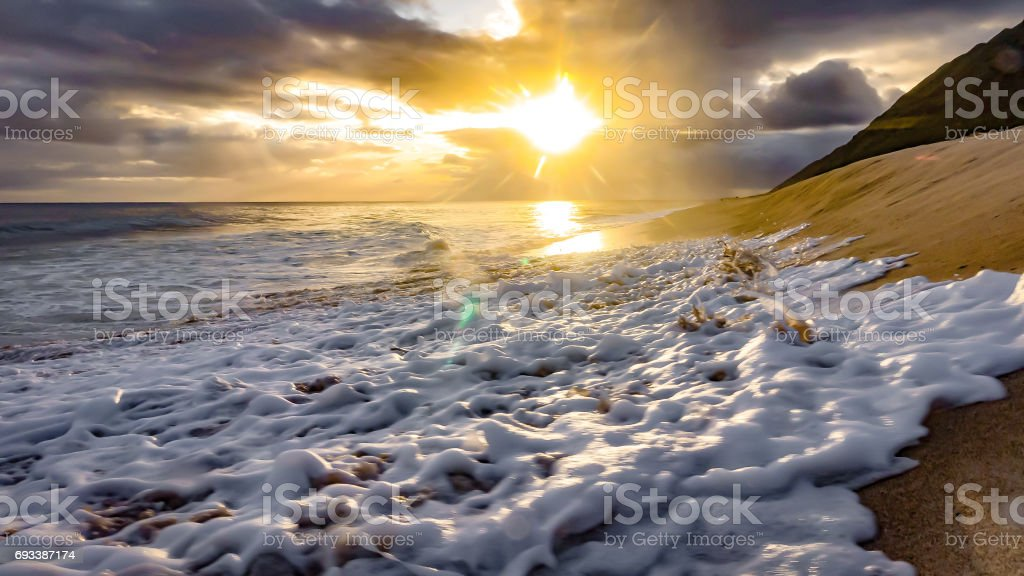 awesome yellow sunset and beach stock photo