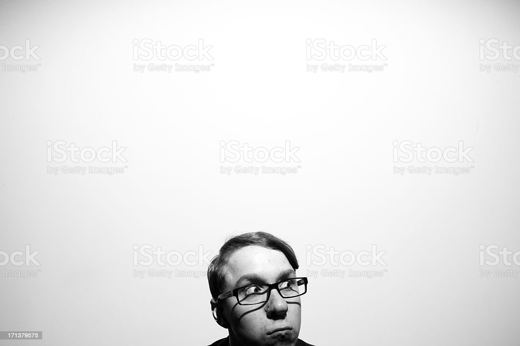 Awkward Looking Short Young Businessman Wearing Glasses Making a Face stock photo