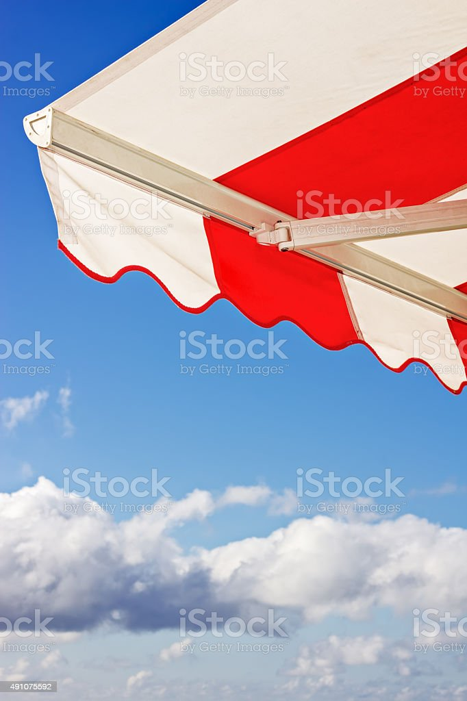 Awning over bright blue sky stock photo
