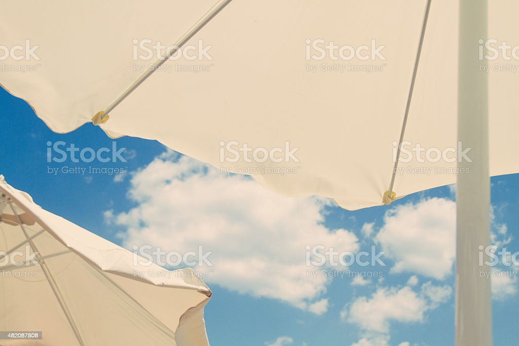 Awning over bright sunny blue sky in vintage tone stock photo