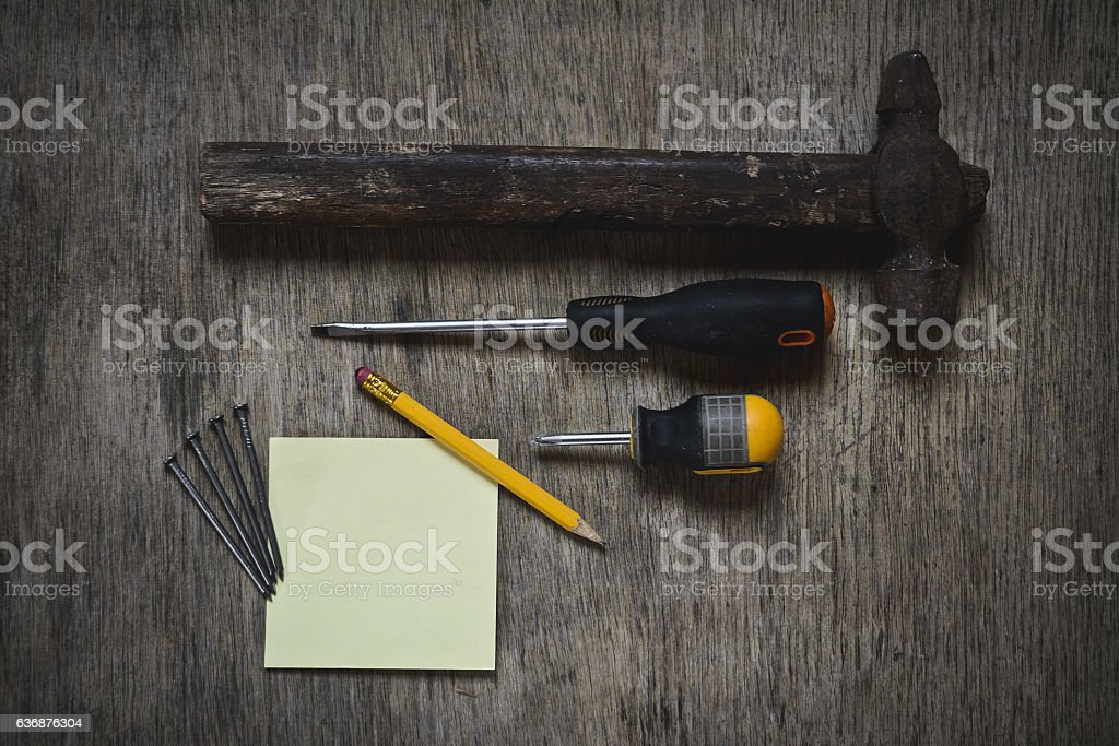 ax, a hammer, a screwdriver and nails stock photo