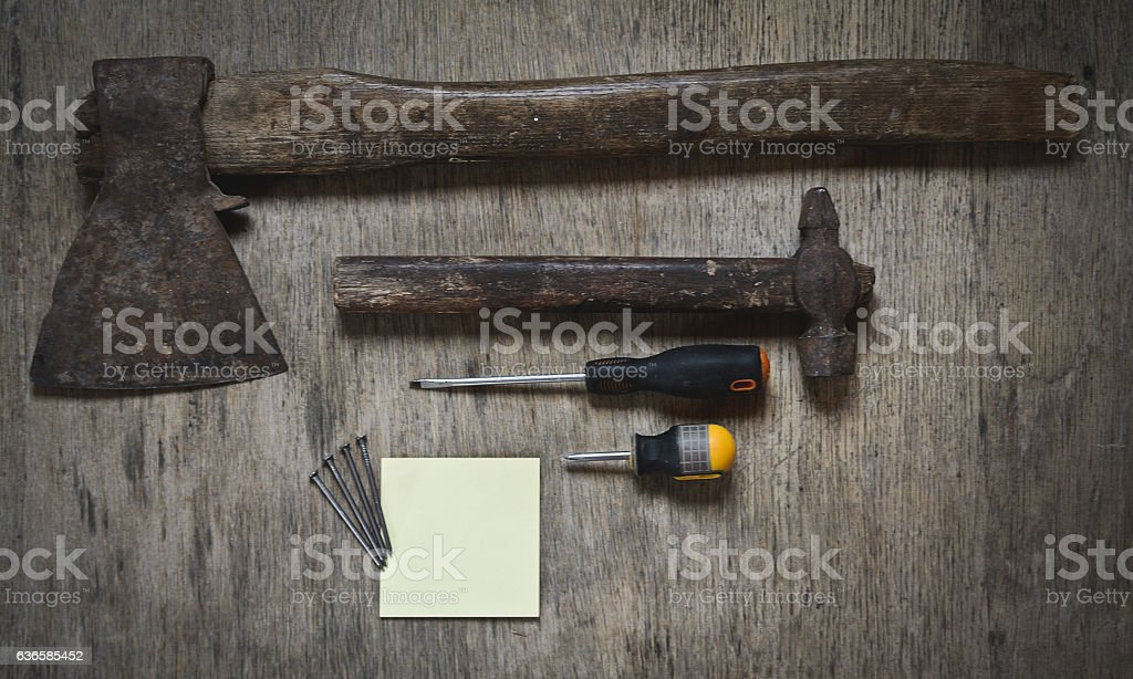 ax, a hammer, a screwdriver and nails. worker abstract and blank stock photo