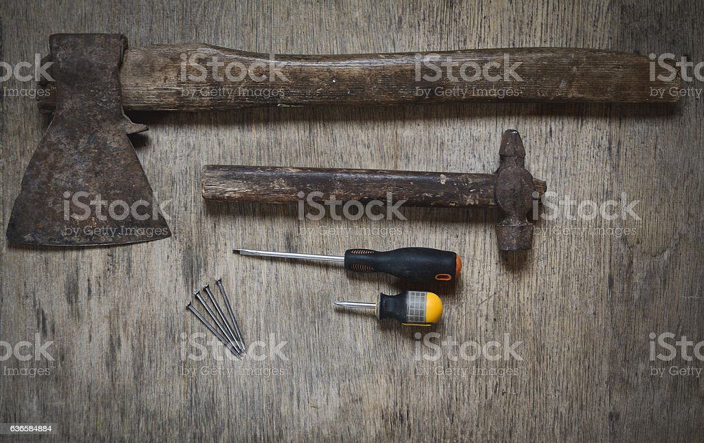 ax, a hammer, a screwdriver and nails. worker abstract stock photo