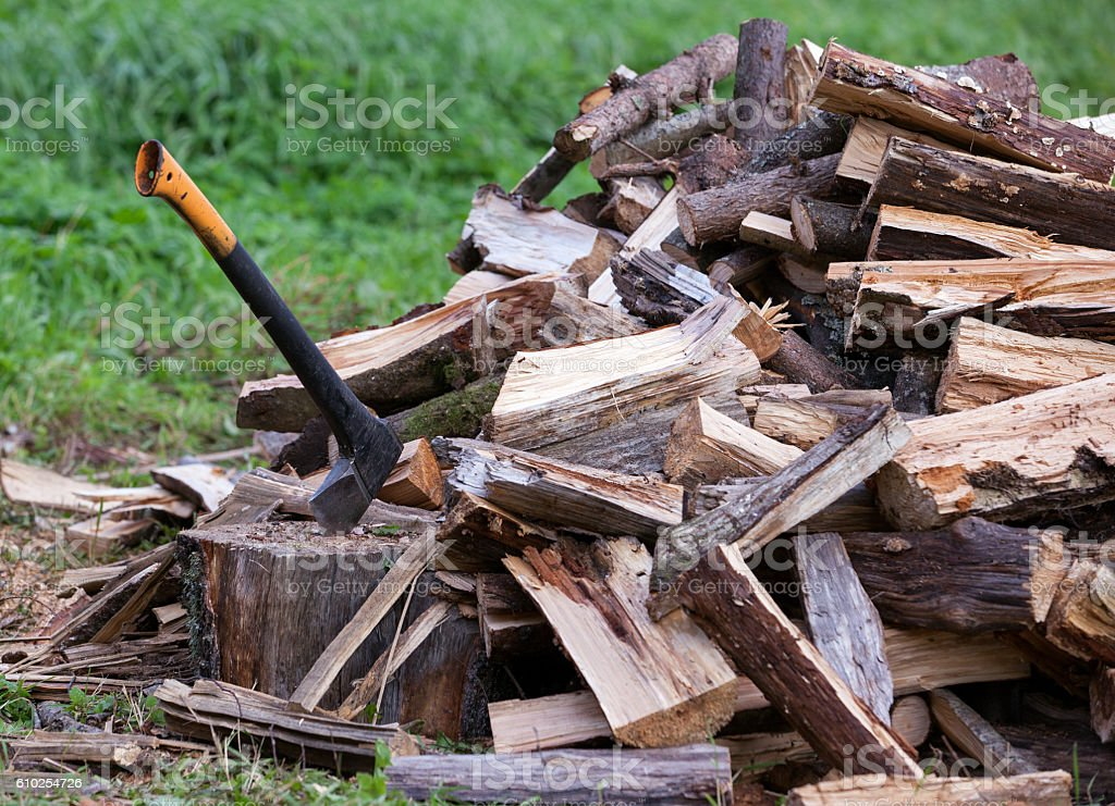 Ax and cuted firewood stack stock photo