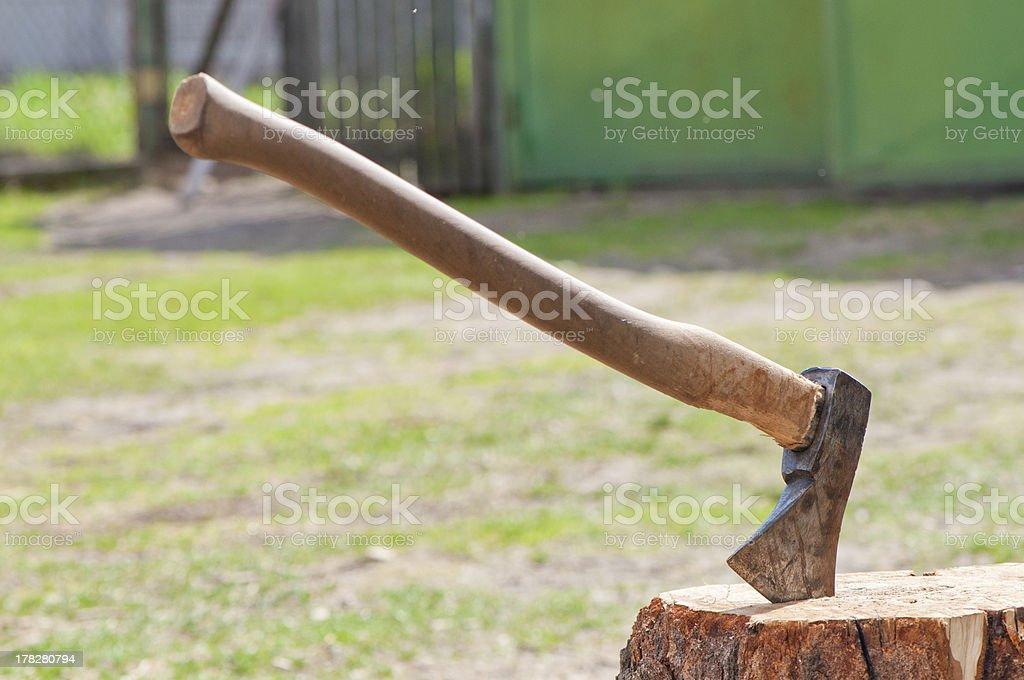ax stuck in the stump royalty-free stock photo