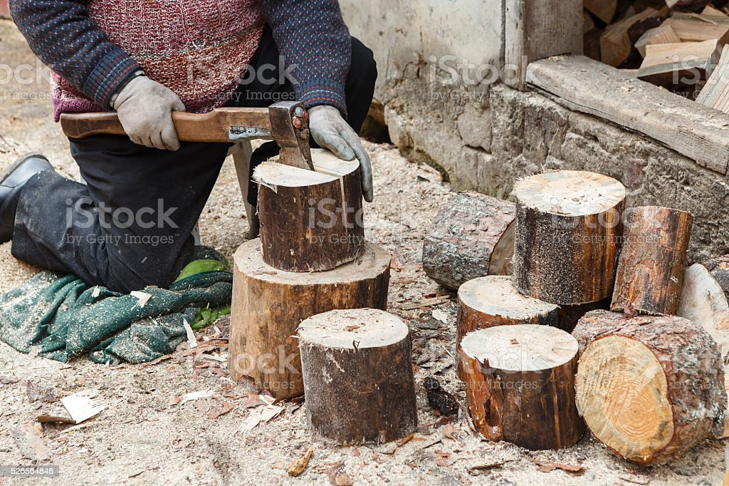 Axe and wood for the fireplace stock photo