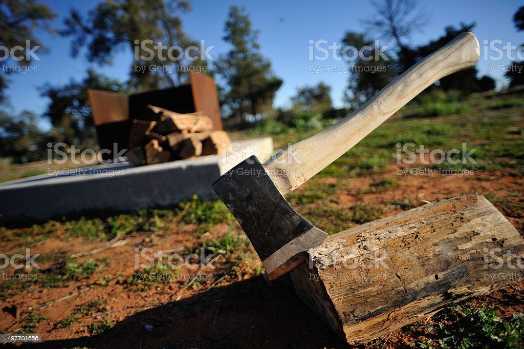 Axe into the wood, Outback Australia, stock photo