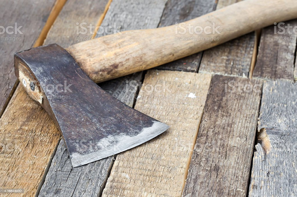 Axe on a wooden background stock photo