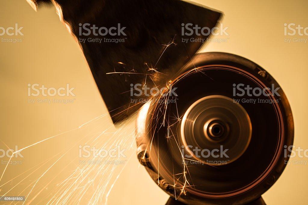 Axe sharpening stock photo