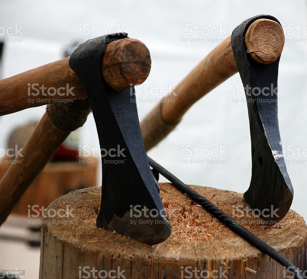 Axes in the stump royalty-free stock photo