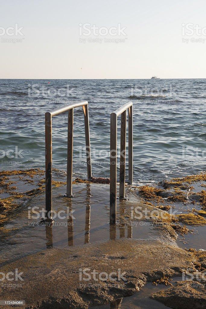 Ayia Napa Cyprus shiny  metal handrail at mediterranean beach royalty-free stock photo