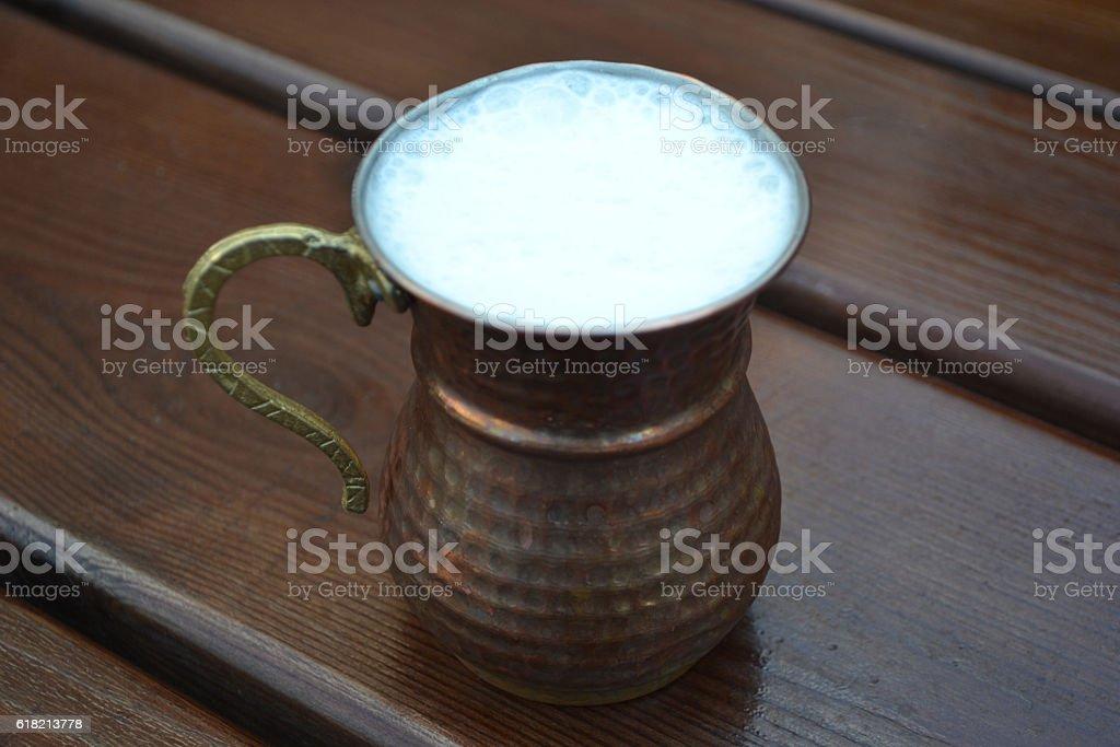 Ayran or lassi in metal cup stock photo