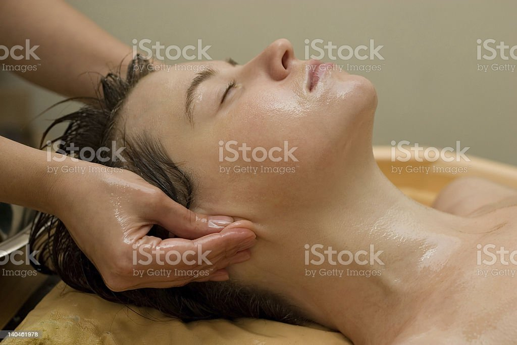 ayurvedic oil massage procedure royalty-free stock photo
