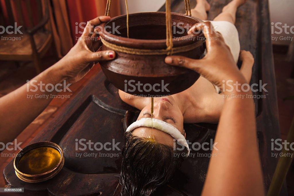 Ayurvedic shirodhara treatment in India stock photo