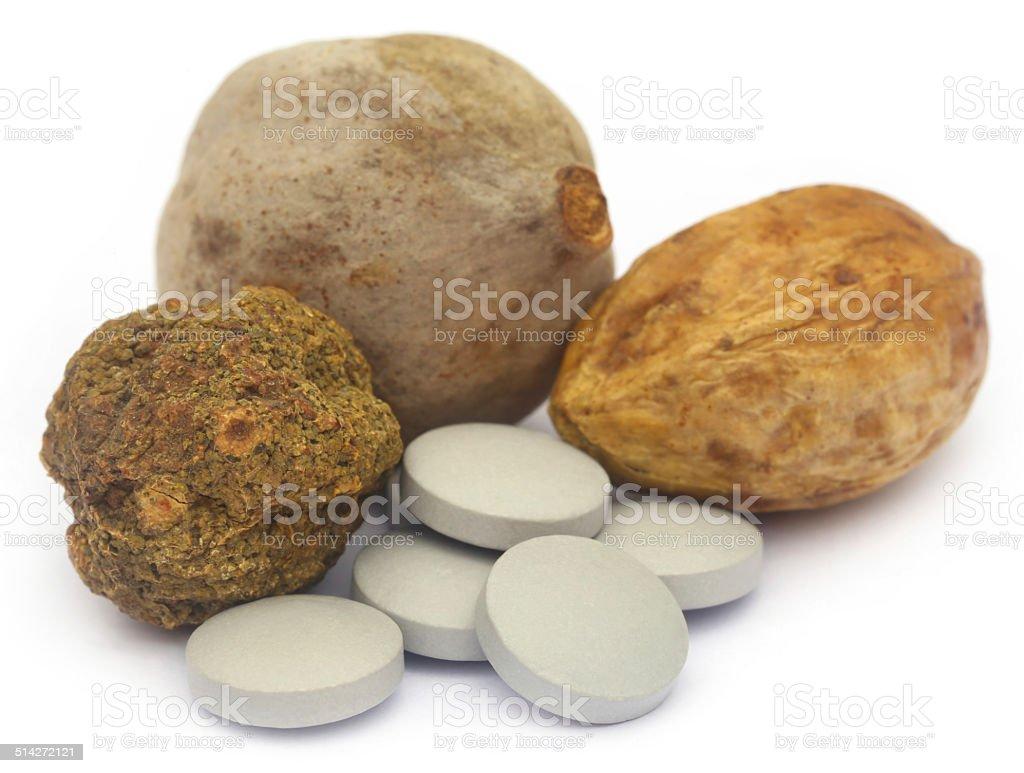 Ayurvedic Triphala with pills stock photo