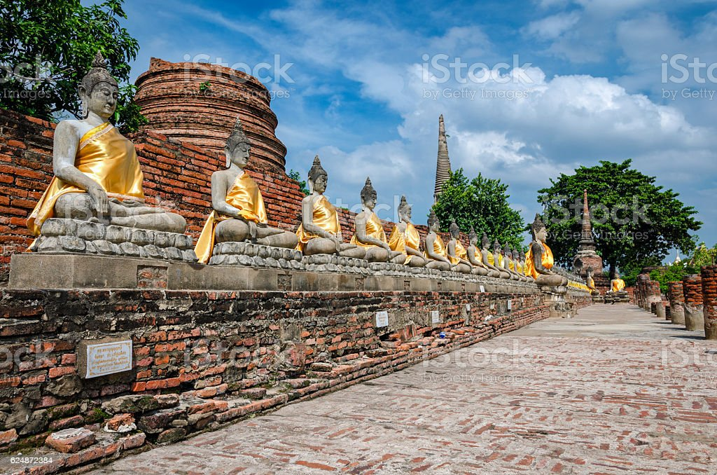 Ayutthaya (Thailand), giant Buddha statues between old temple ruins stock photo