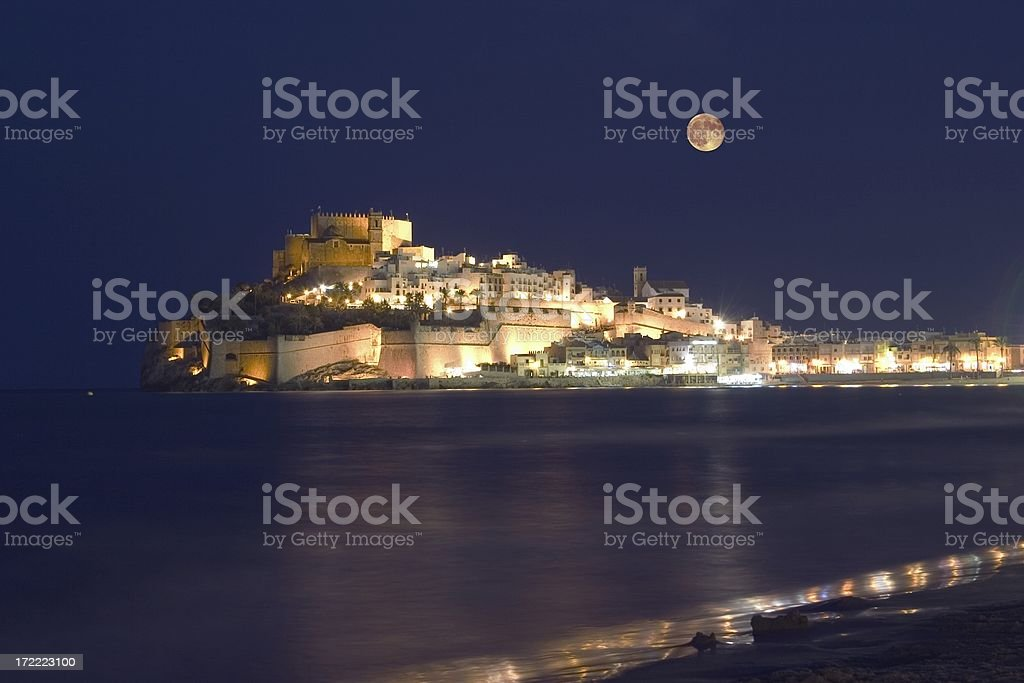 Azahar Costa Peniscola ,Castle Papa Luna with rising Moon stock photo