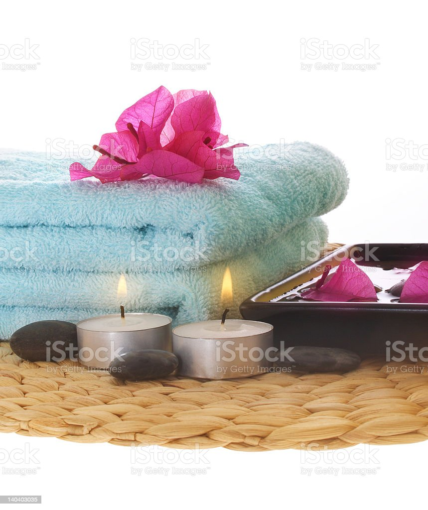 Azalea,candle and blue towel on mat royalty-free stock photo