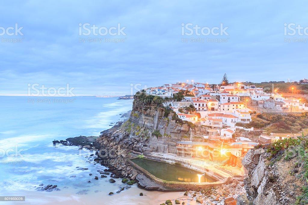 Azenhas do Mar village at dusk with stormy sea stock photo