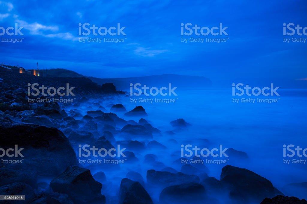Azores dusk sea shore stock photo