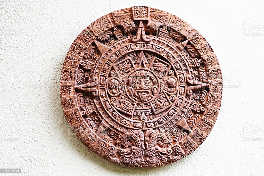 Aztec Stone of the Sun plaque  hung on wall stock photo