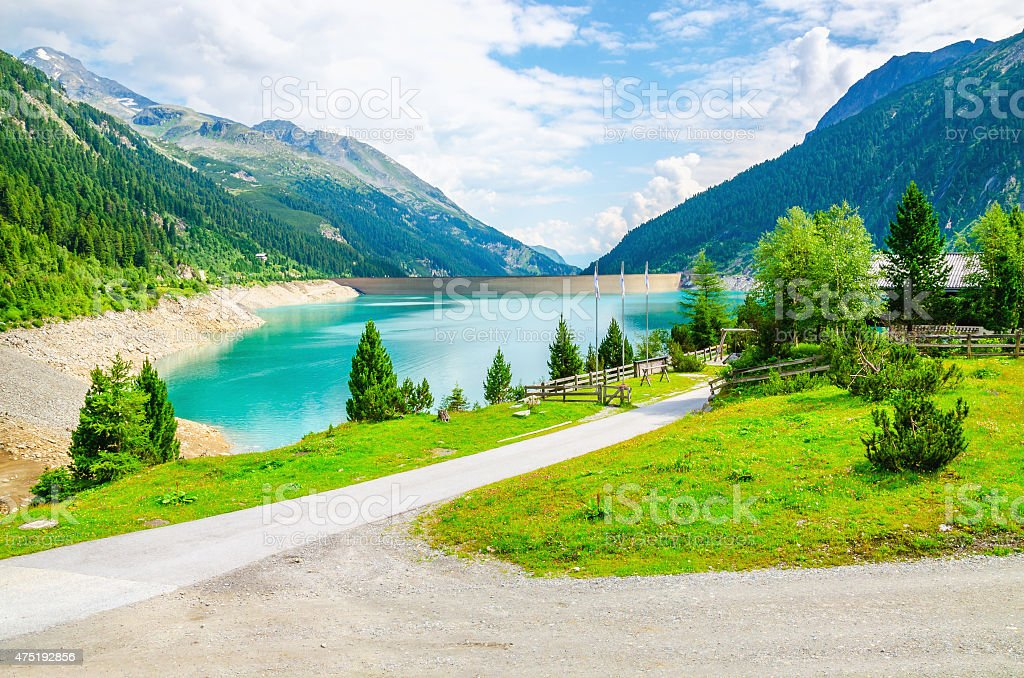 Azure lakewith peaks of the Alps, Austria stock photo