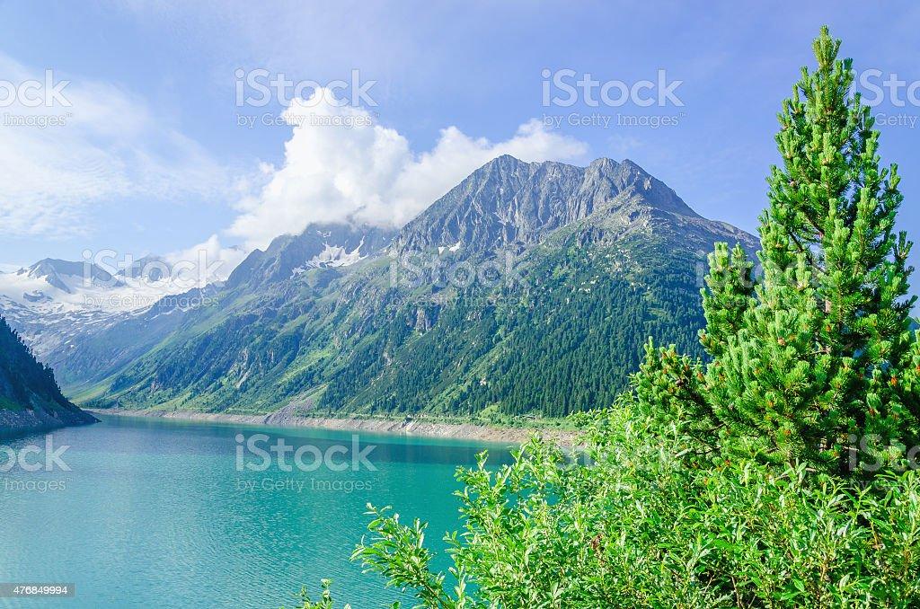 Azure mountain lake and high Alpine peaks, Austria stock photo