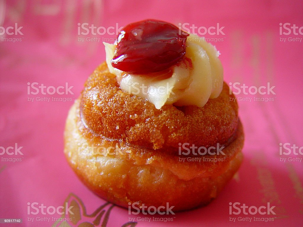 Baba au Rum with Whipped Cream and Cherry stock photo