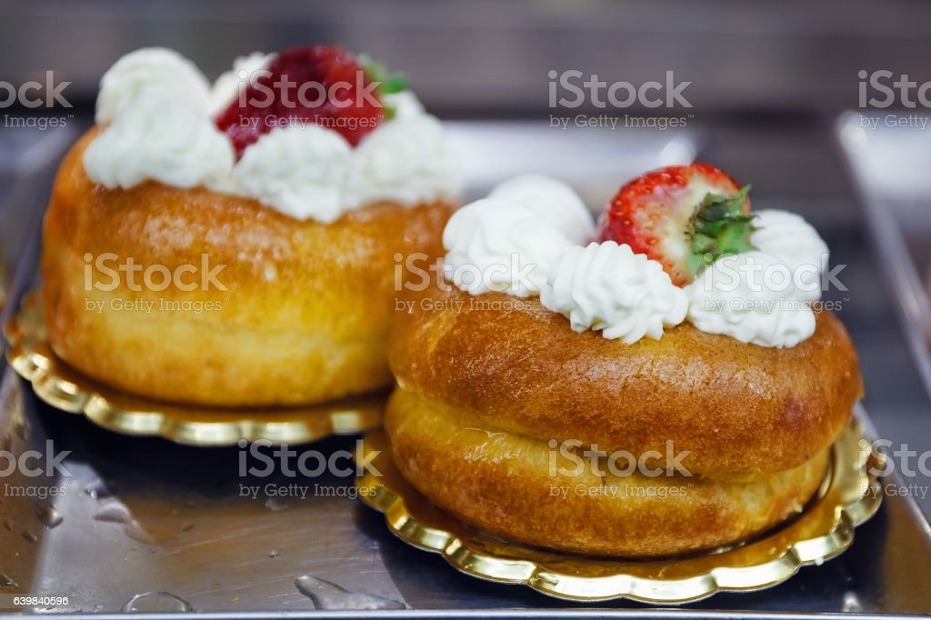 Baba with white cream and strawberry stock photo