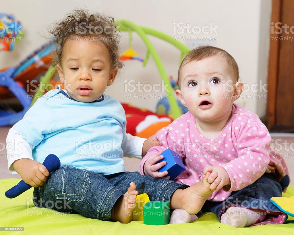 Babies Enjoying Interactive Play stock photo