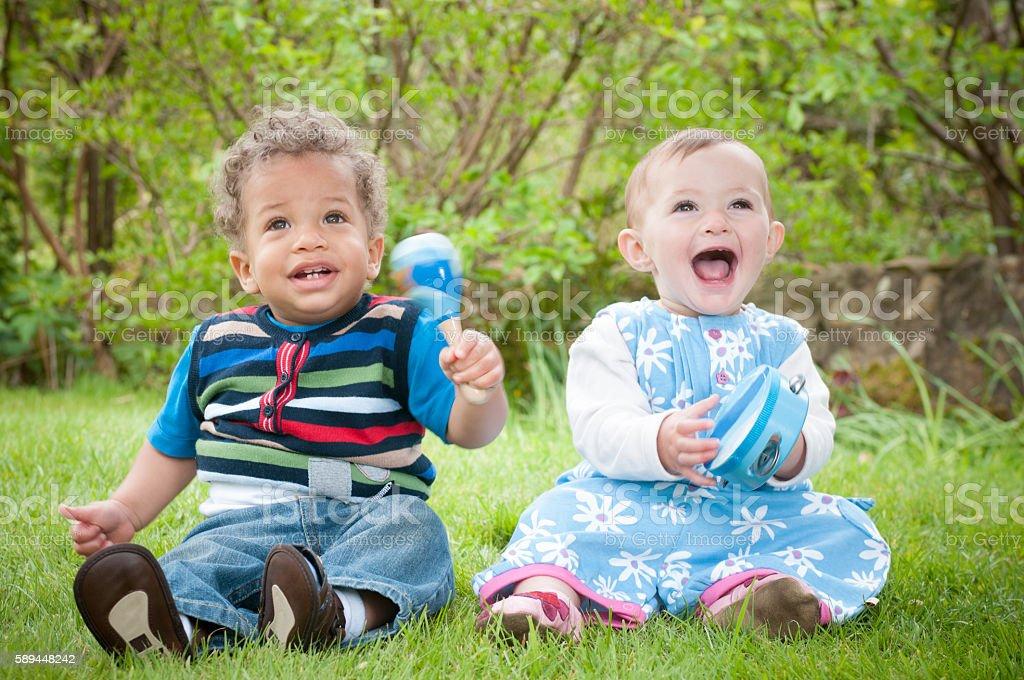 Babies Enjoying Music Through Play stock photo