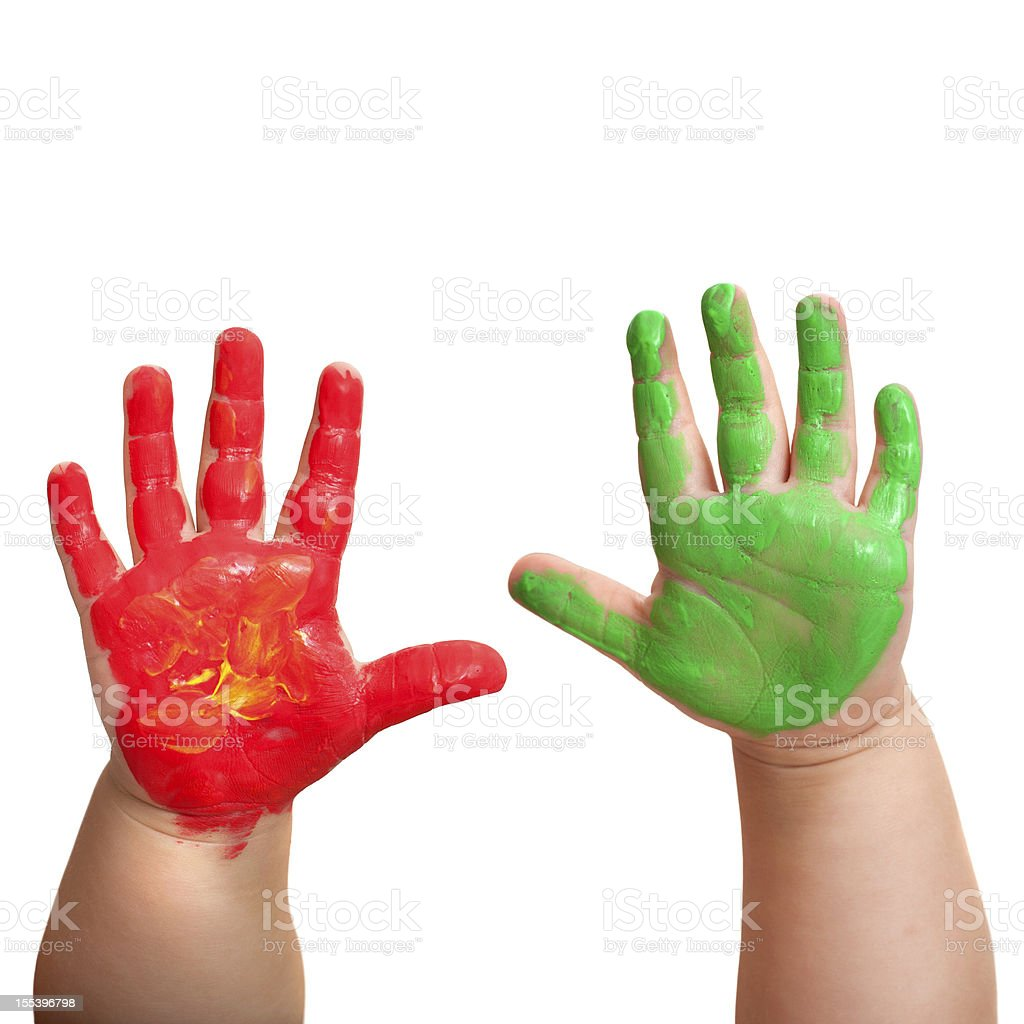 Bébés main dans de peinture de couleur vive. photo libre de droits