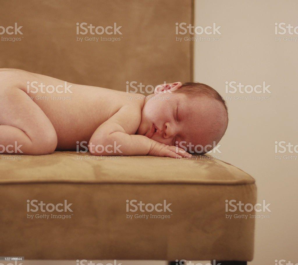 Babies: Newborn sleeping on plush velvet chair stock photo