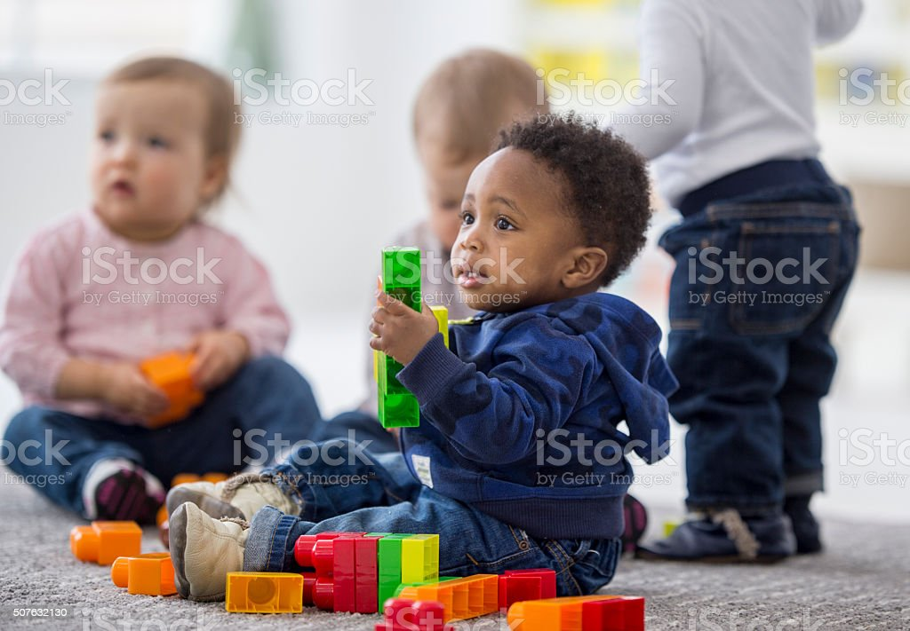 Babies playing together in preschool. royalty-free stock photo