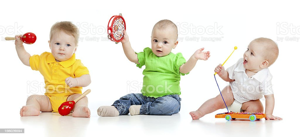 Babies playing with musical toys royalty-free stock photo