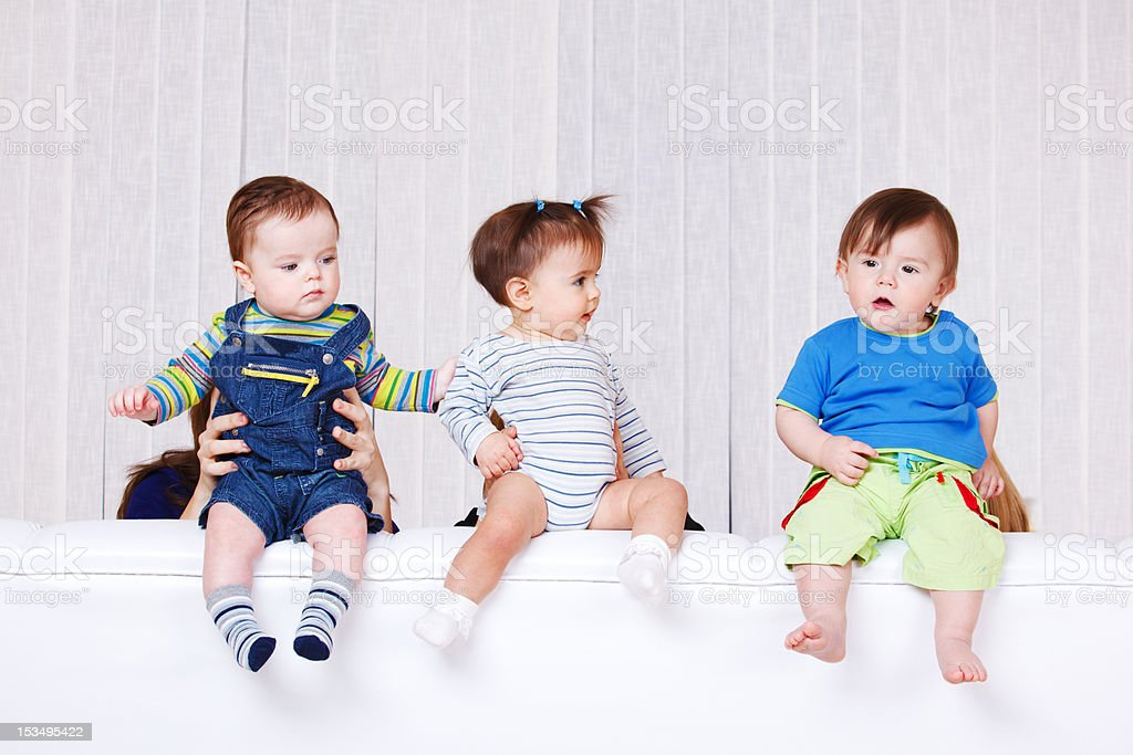 Babies sitting on the sofa back royalty-free stock photo