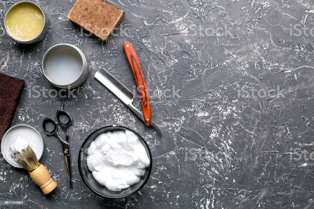babrer workplace with tools on gray background top view mock up stock photo