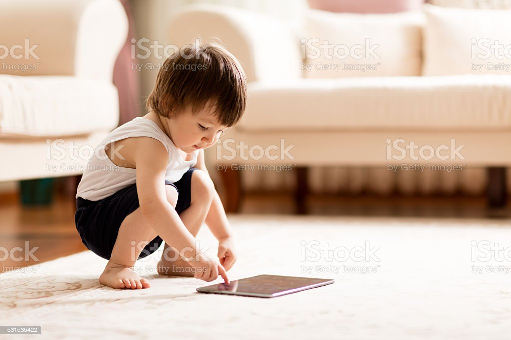 Baby abd Tablet stock photo