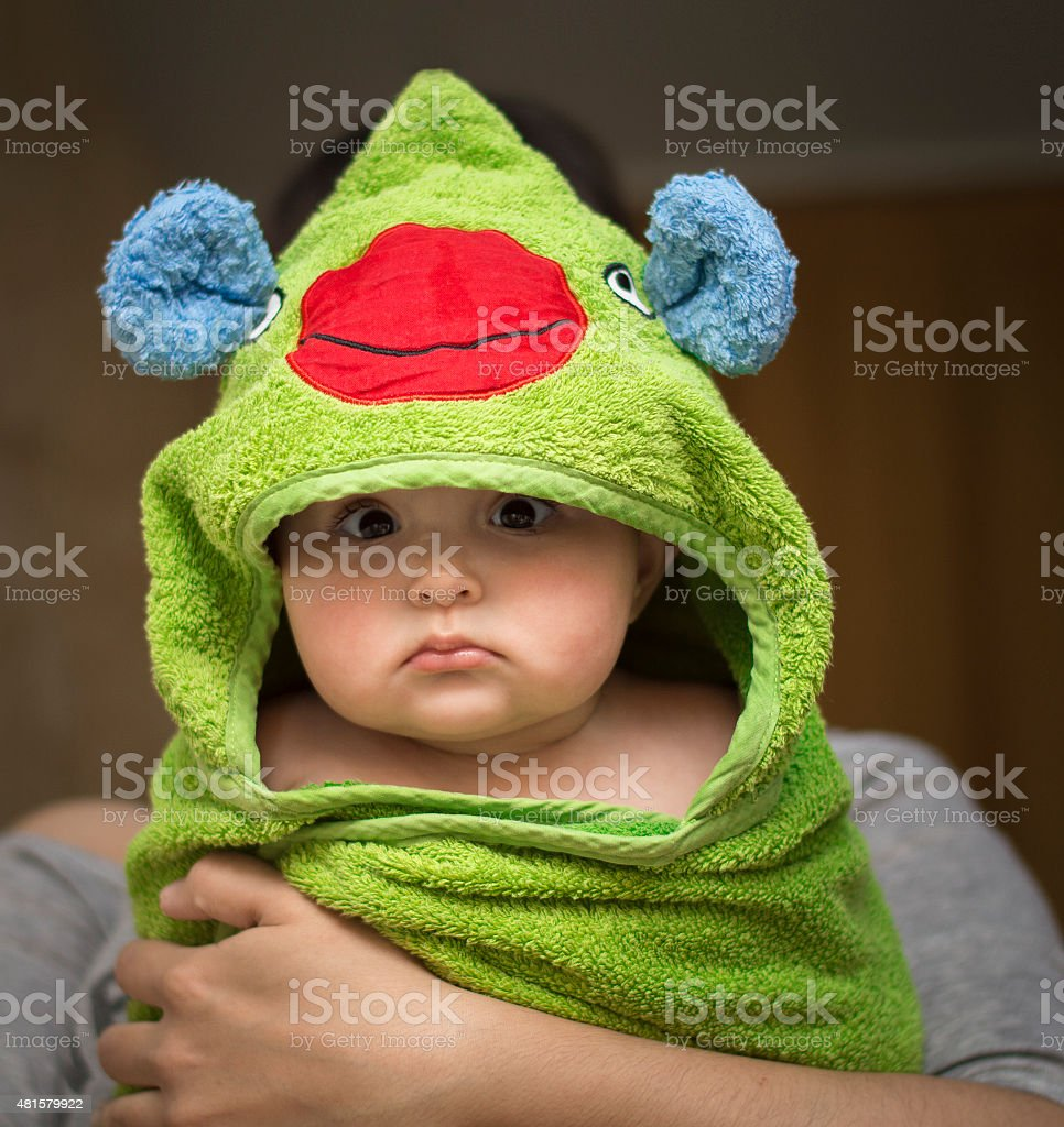 baby after bath in towel funny stock photo