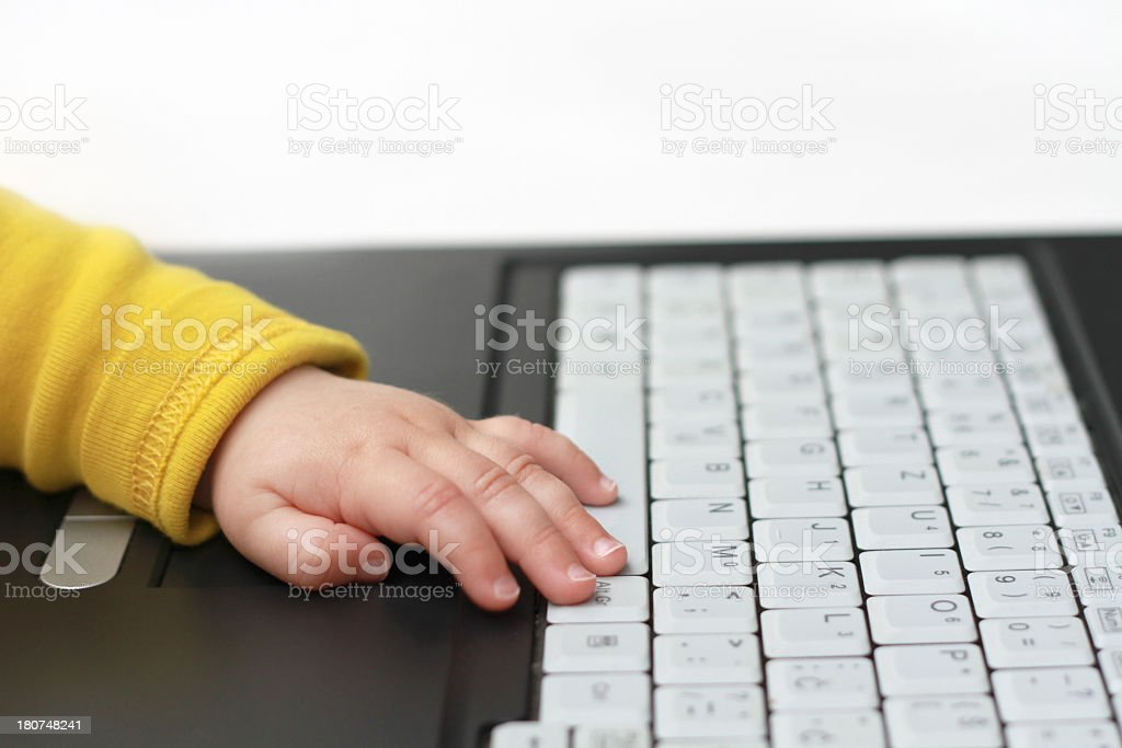 baby and computer stock photo