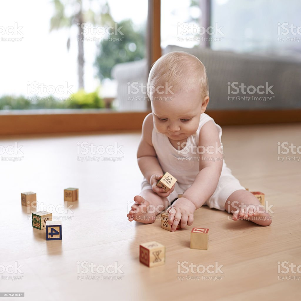 Baby and her blocks stock photo