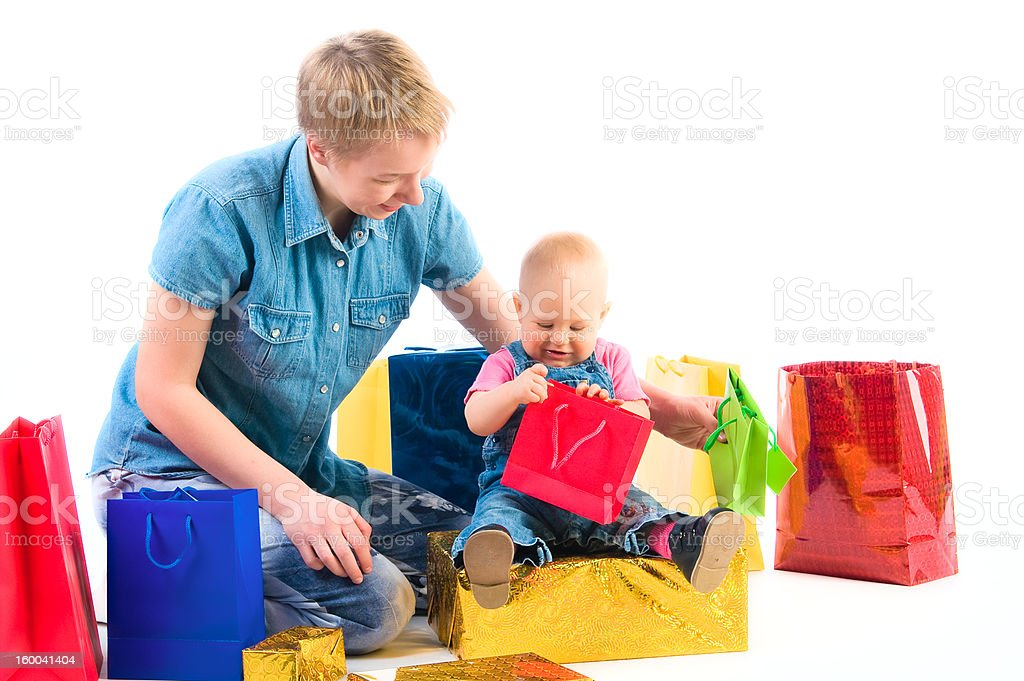 Baby and mother with gifts royalty-free stock photo