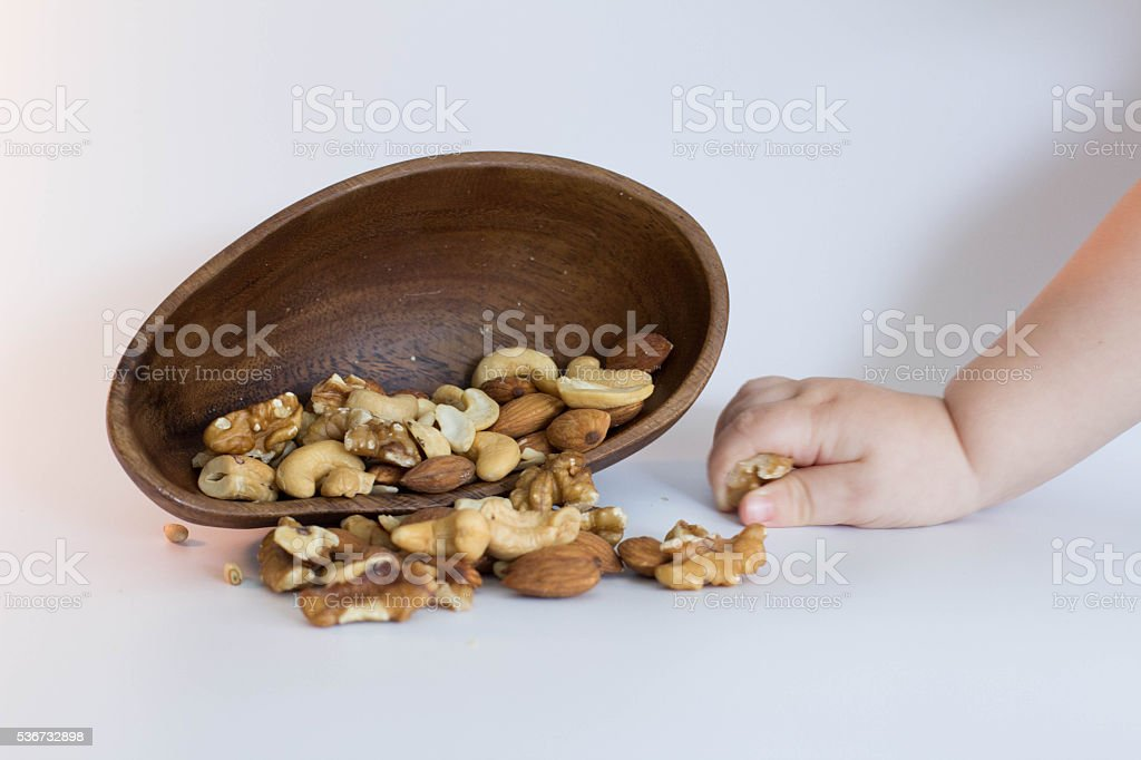 baby and nuts stock photo