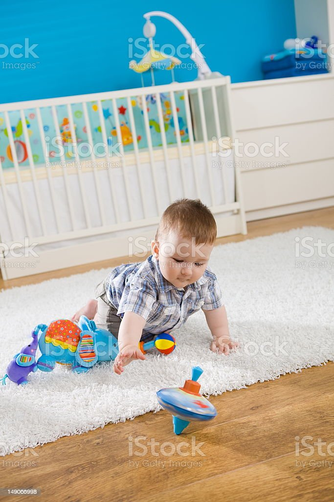 Baby and spinning top stock photo