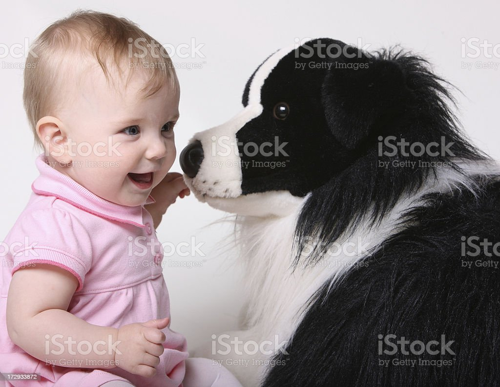 Baby and Stuffed Dog royalty-free stock photo