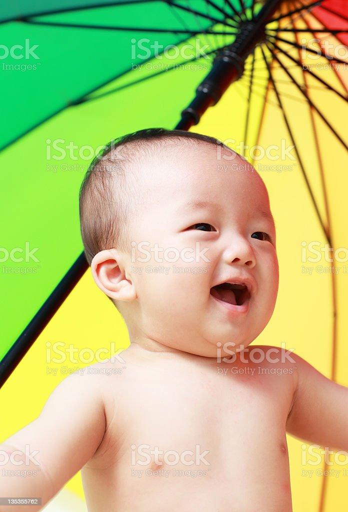 Baby and Umbrella royalty-free stock photo