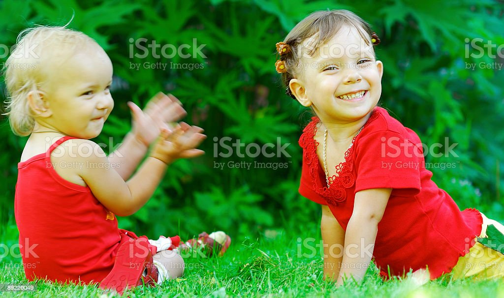 Baby applauds sister royalty-free stock photo