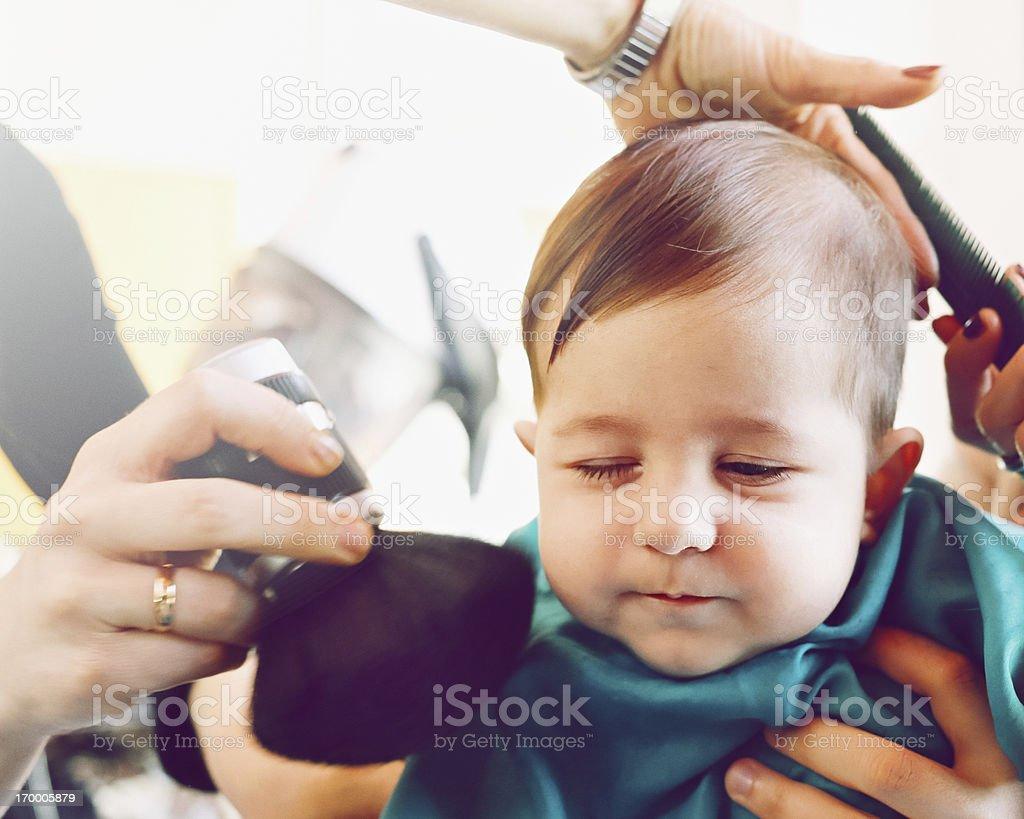 Baby at the hair salon stock photo